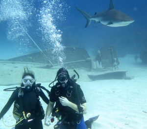 Ty and Michelle Holm with overhead shark in Grand Bahama